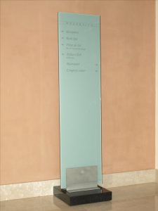 glass column with signs